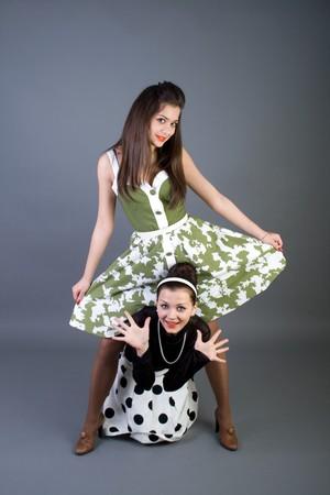 Two  happy retro-styled girls  photo