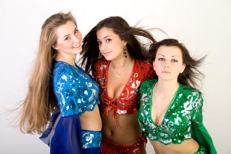 Three girls belly dancing in studio