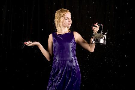 Portrait of a woman in water studio