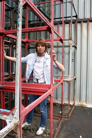area sexy: Man standing among metal constructions in city Stock Photo