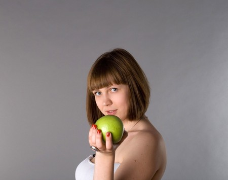 Woman with apple photo
