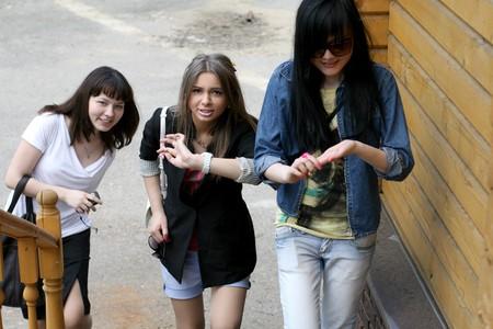 Three female friends rushing photo