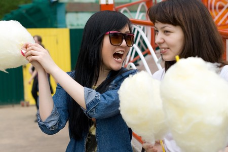 Two girls eating candy floss