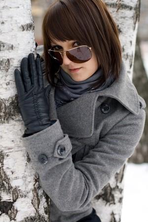 Closeup portrait of a girl walking in winter park photo