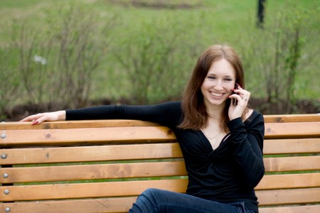 Girl talking by phone outdoor photo