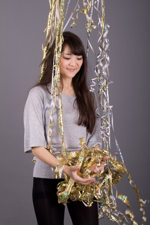 Girl with tinsel Stock Photo - 7047652
