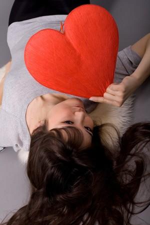 Beautiful woman holding red heart Stock Photo - 7047669