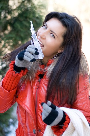 Funny girl with an icicle photo