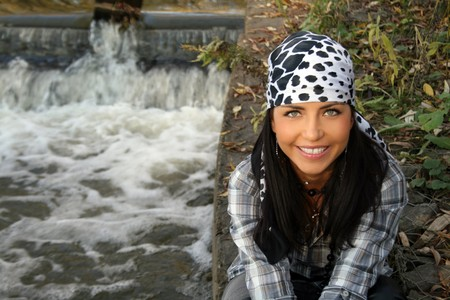 Female pirate sitting near waterfall Stock Photo - 7063341