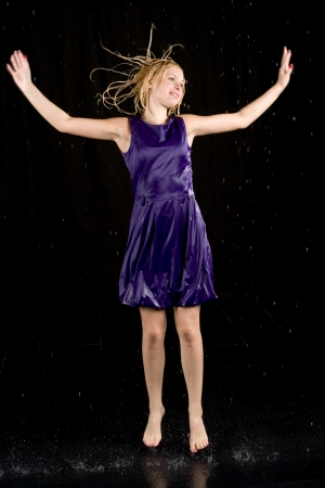 Full length portrait of a woman in water studio  photo