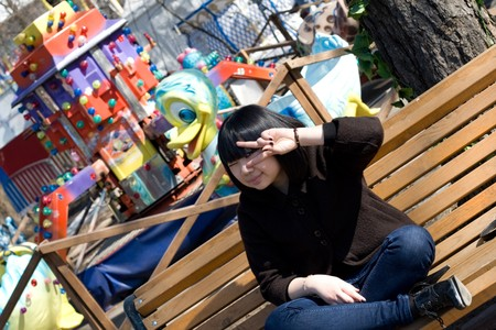 Funny girl in an amusement park photo