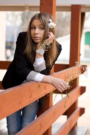 verandah: Girl standing on a verandah   Stock Photo