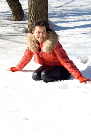 snowdrift: Happy girl walking outdoor in a snowdrift