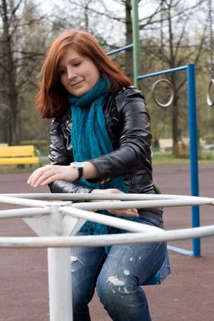 Sportive girl riding carousel Stock Photo