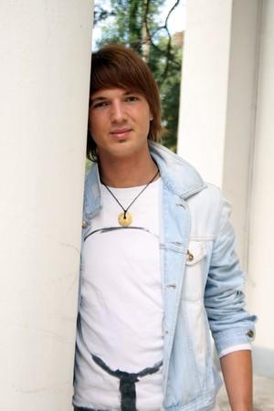 Handsome man standing near column outdoor photo