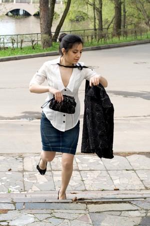 Business woman rushing  photo