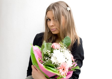 Girl with a bunch of flowers photo