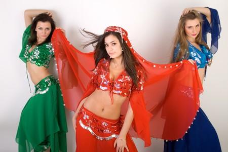 Three girls belly dancing in studio Stock Photo - 7096477