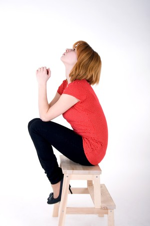 Pretty girl sitting on a chair photo