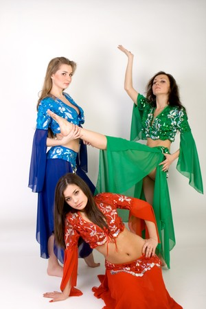 Three girls belly dancing in studio photo