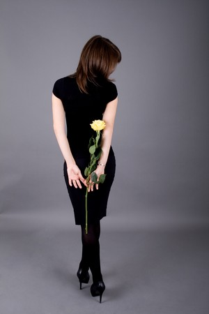 Beautiful girl with rose photo