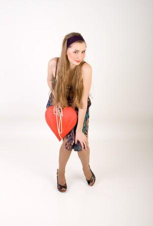 Beautiful woman holding red heart photo