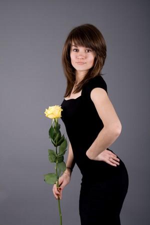 Beautiful girl with yellow rose photo