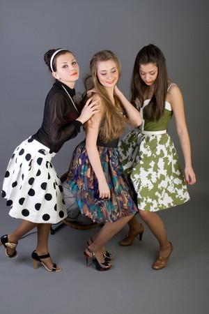 Three happy retro-styled girls  photo
