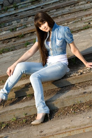 Girl sitting on stairs outdoor photo