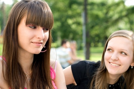 Two female friends sitting on bench Stock Photo - 7369412