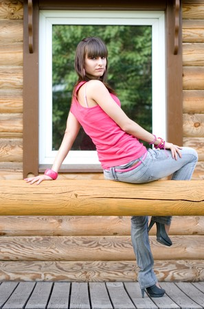 Girl sitting on a veranda  photo