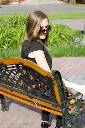 Girl sitting on bench photo