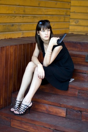 Girl sitting on stairs outdoor Stock Photo
