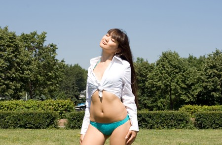 Girl in bikini sunbathing outdoor  photo