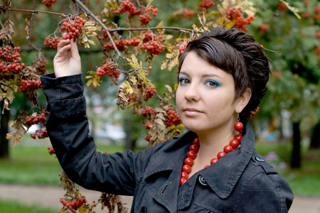 Pretty girl walking in autumn park photo