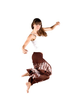 Girl in ethnic clothes jumping photo
