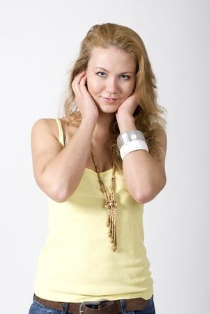 Smiling girl posing in studio photo