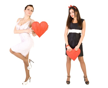 Two girls with red hearts photo