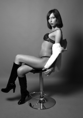 Sexy woman xitting on chair Stock Photo - 8659664
