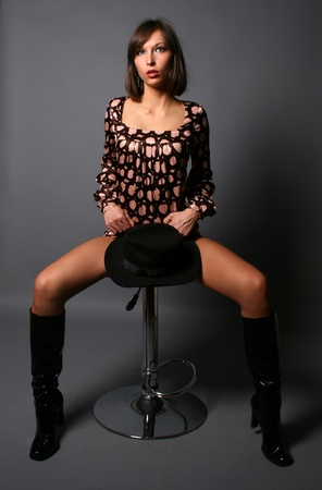 Sexy girl sitting on chair photo