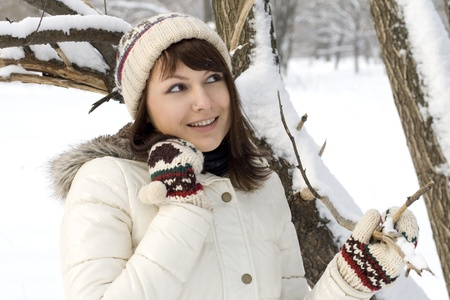 Cute girl walking in winter forest photo