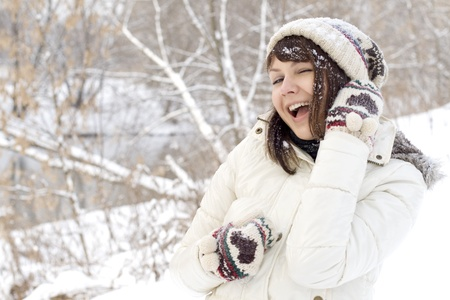 Closeup portrait of a cute girl walking outdoor in winter photo