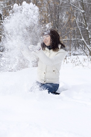 Happy girl having fun outdoor in winter photo