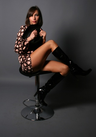 Beautiful woman sitting on chair studio shot photo