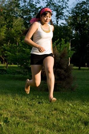 Girl walking outdoor in park photo