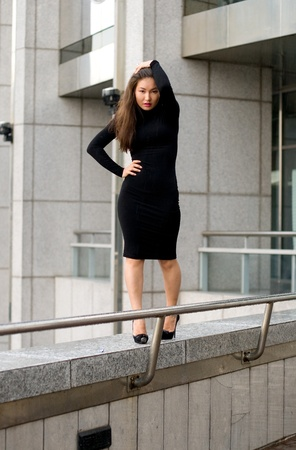Sexy girl in black dress walking in city Stock Photo - 9952656