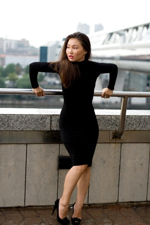 Sexy girl in black dress walking in city Stock Photo - 9952645