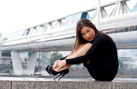 Sexy girl in black dress in city photo