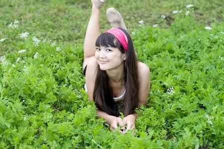 Pretty girl lying on grass photo