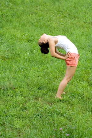 Girl doing exercises in park photo